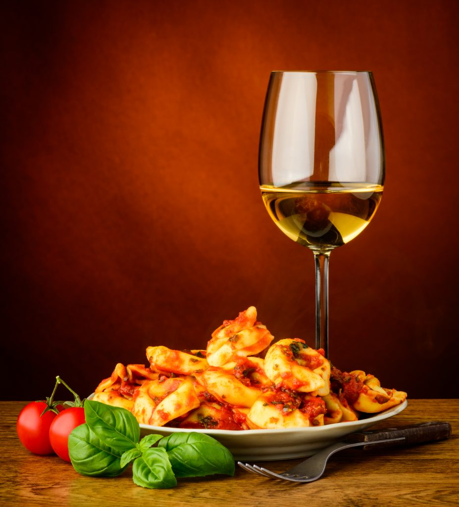 Pasta dish and wine